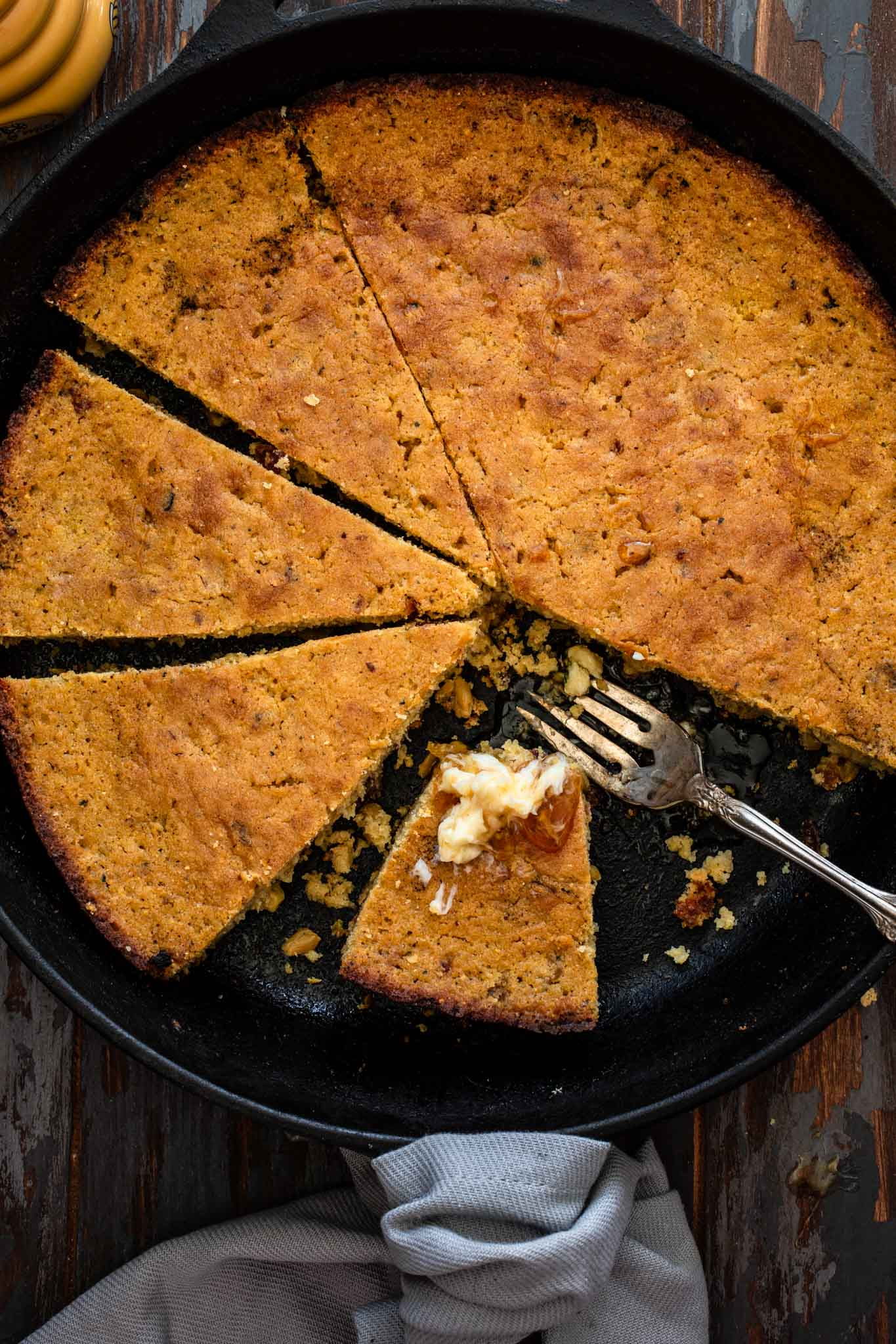 Sliced cornbread in a skillet