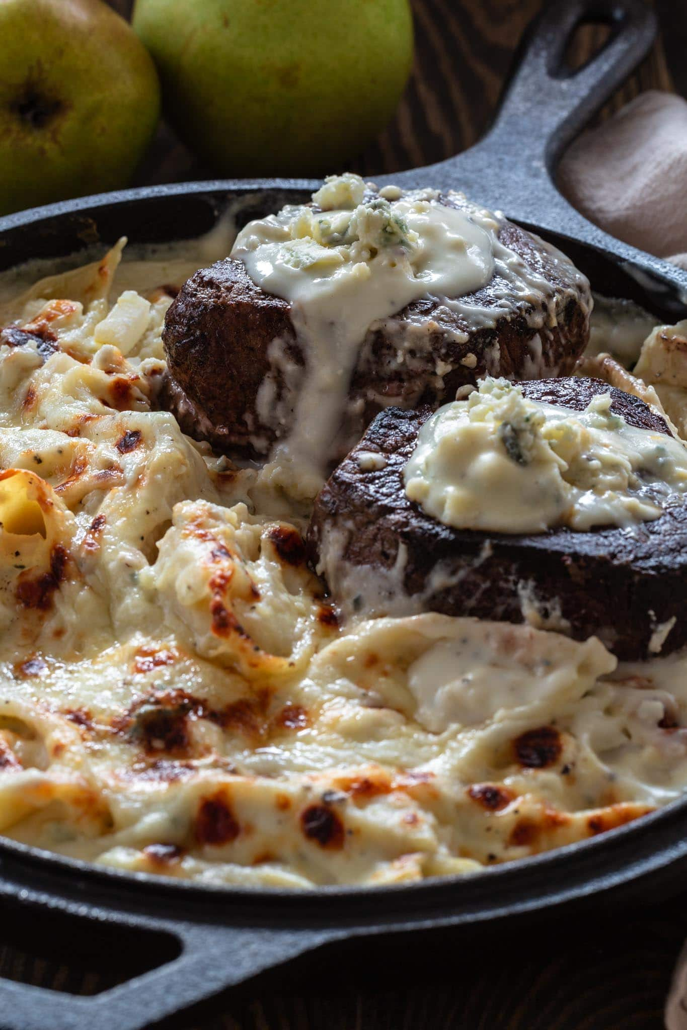 Two succulent filet mignon steaks topped with gorgonzola sauce and served with conchiglioni gratin.