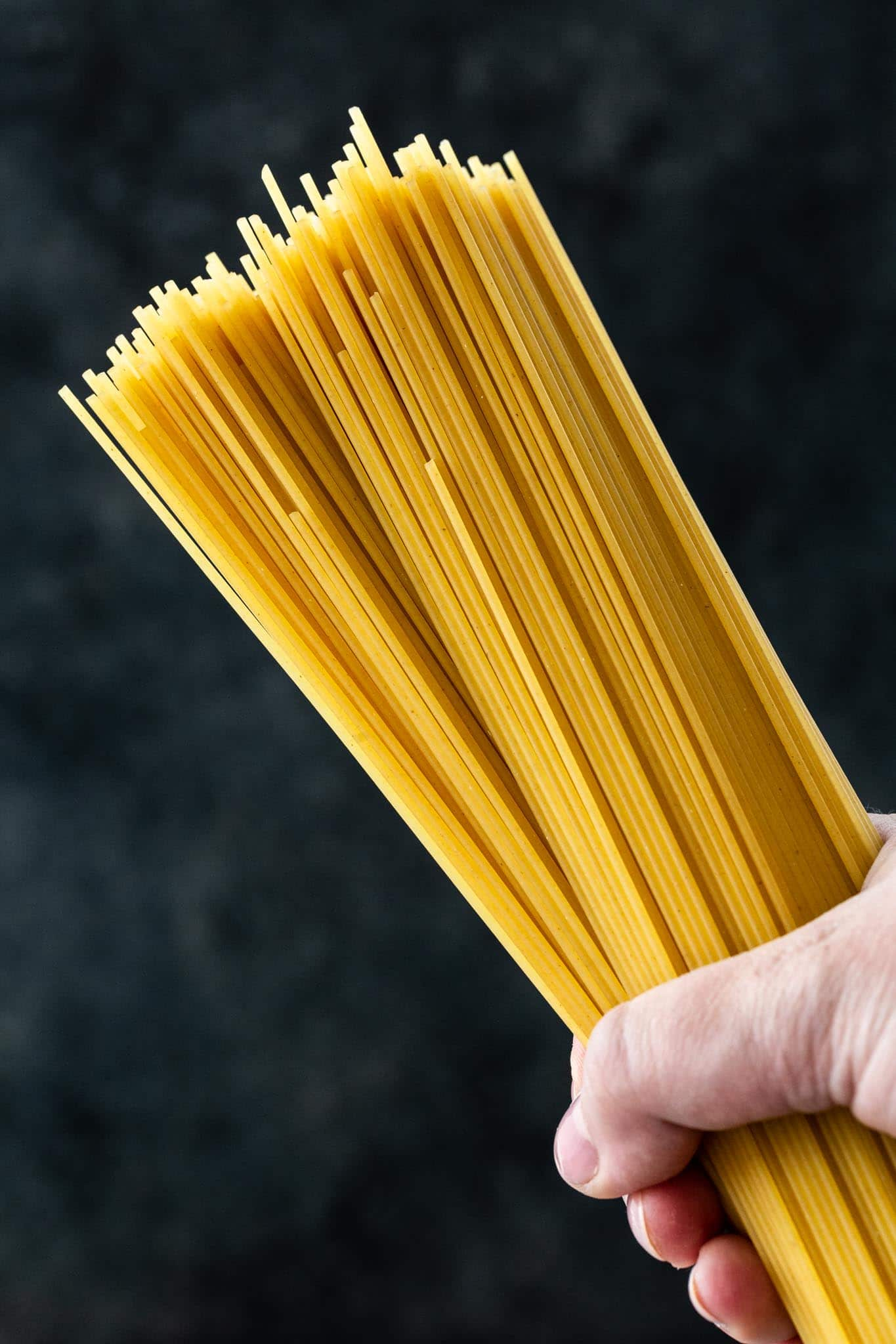 A handful of uncooked spaghetti.