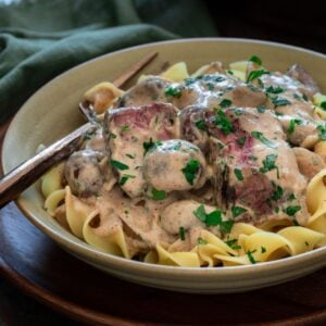 Thumbnail of beef stroganoff over noodles.