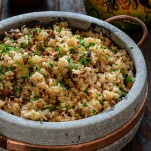 A pot of rice with sausage and lentils.