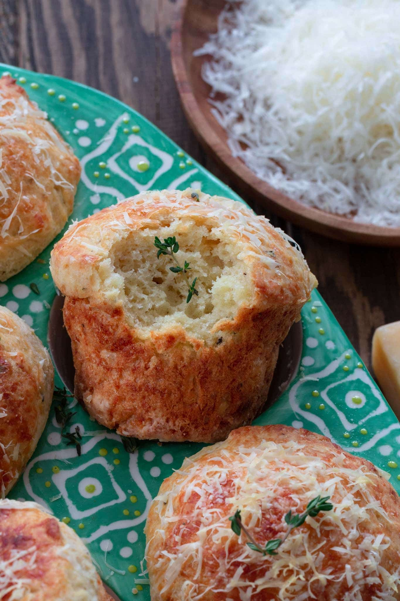 A close up of the inside of a parmesan cheese muffin