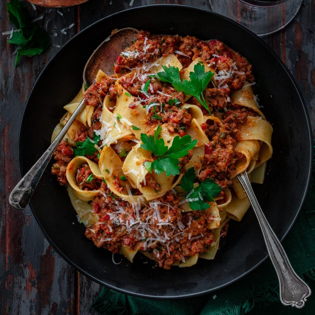 A serving of pasta with bolognese sauce