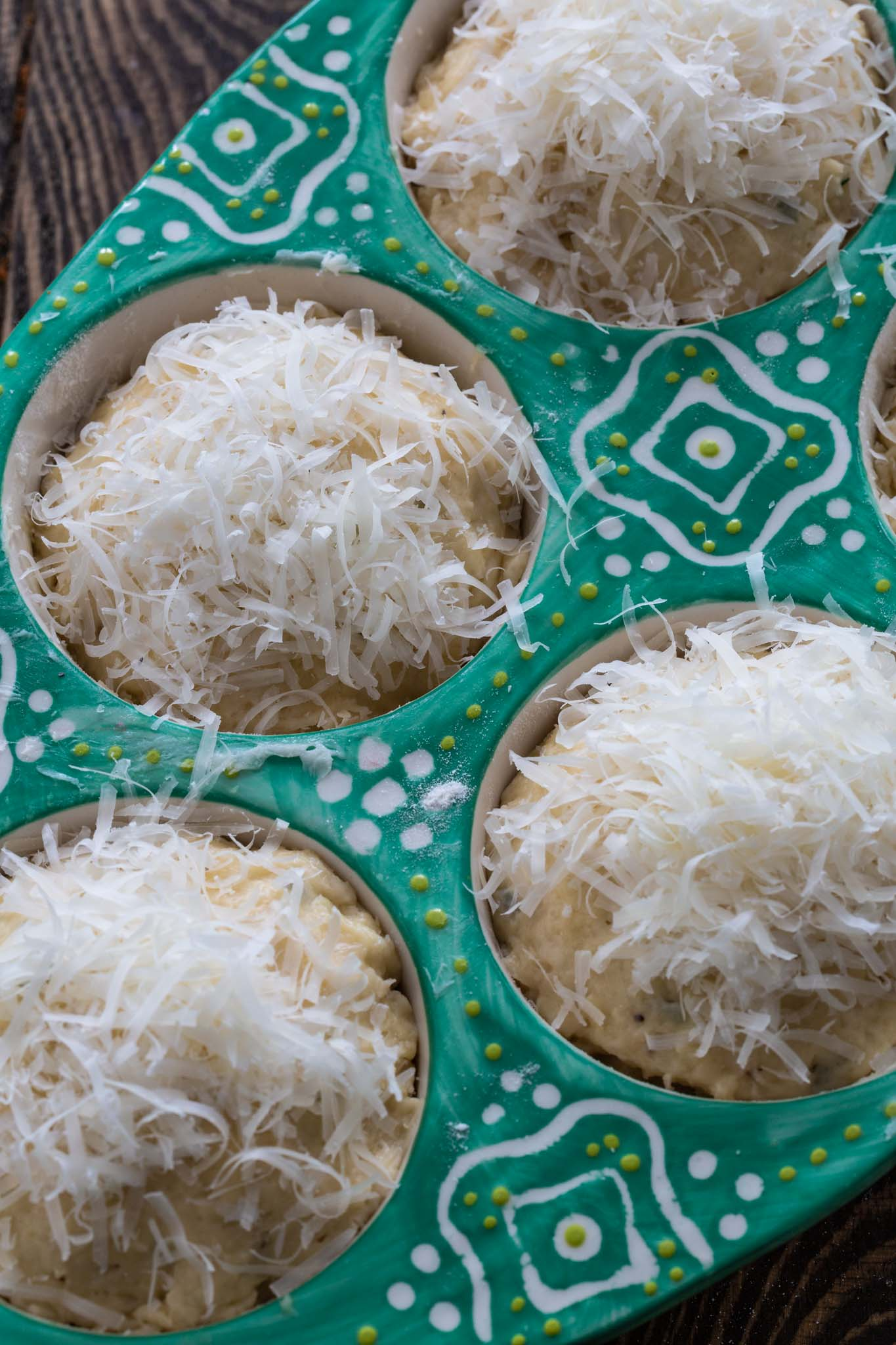 A tin of parmesan muffins before going to the oven.