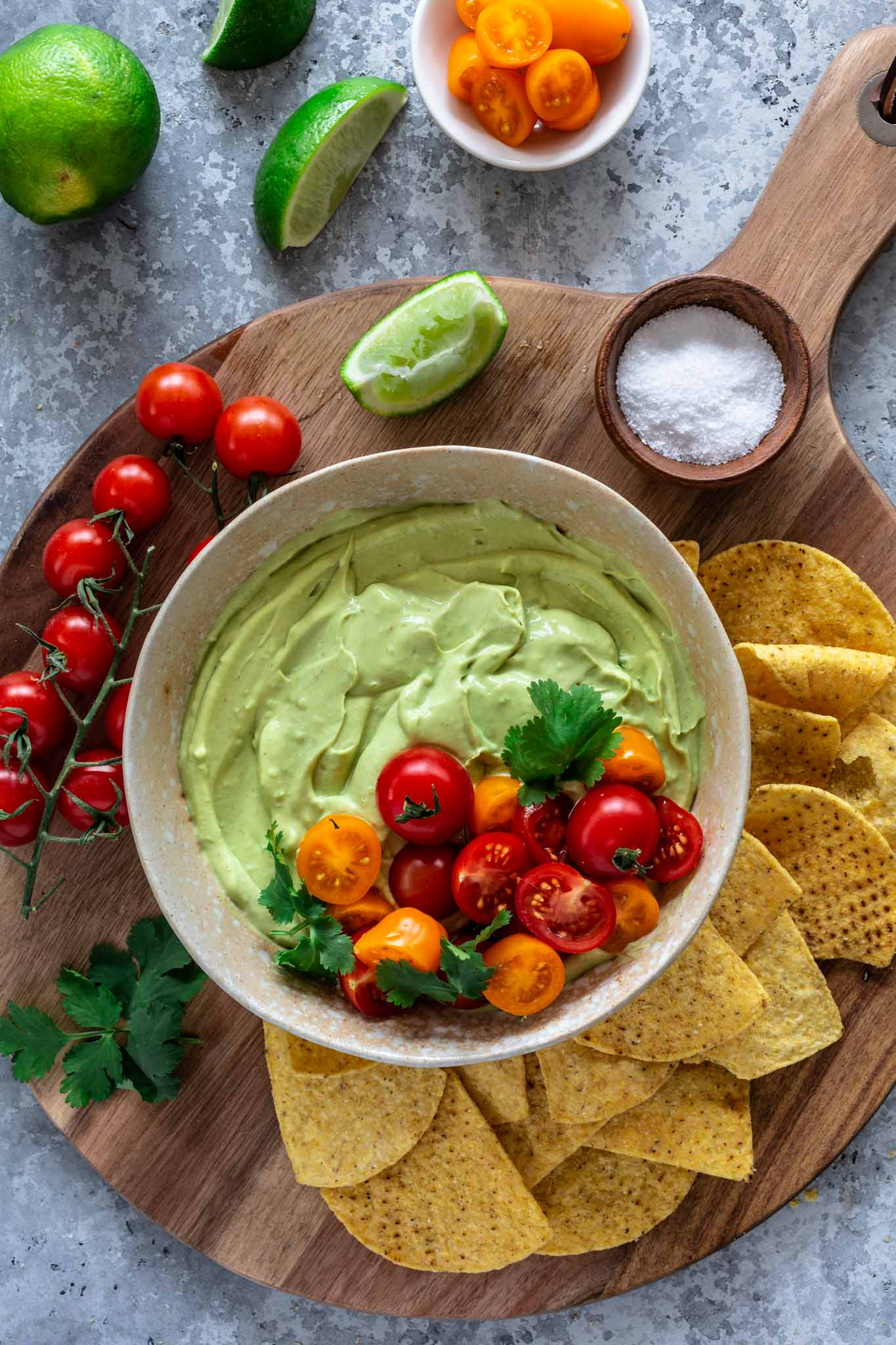 Whipped avocado dip topped with tomatoes and served with tortillas.