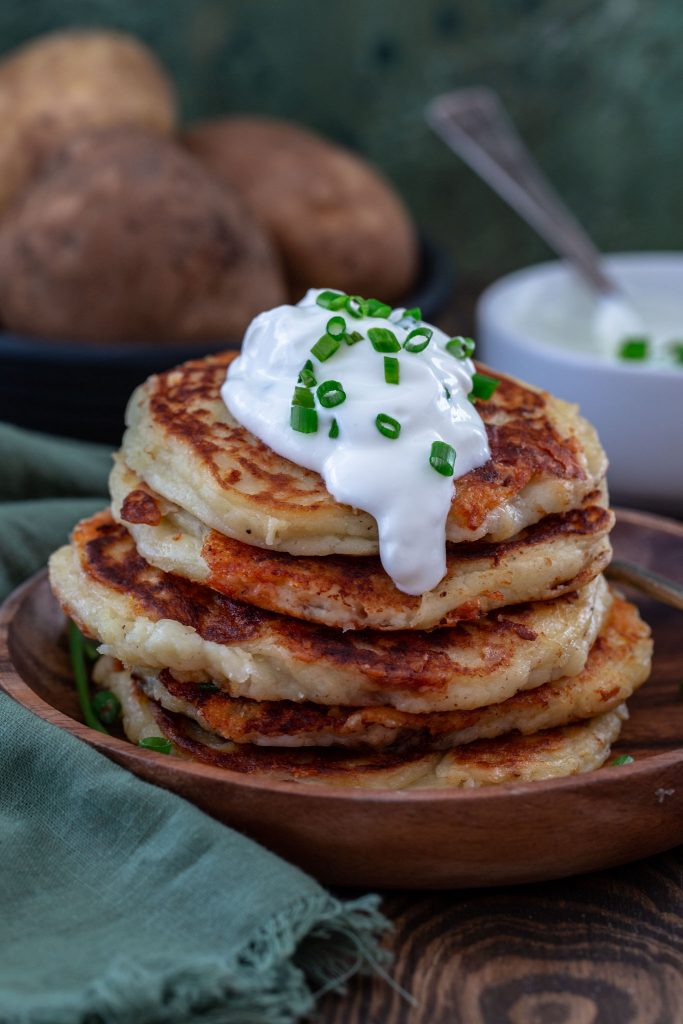 Boxty (also known as Irish Potato Pancakes) topped with sour cream and chives.