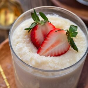 A close up shot of a glass of Brazilian coconut pudding.