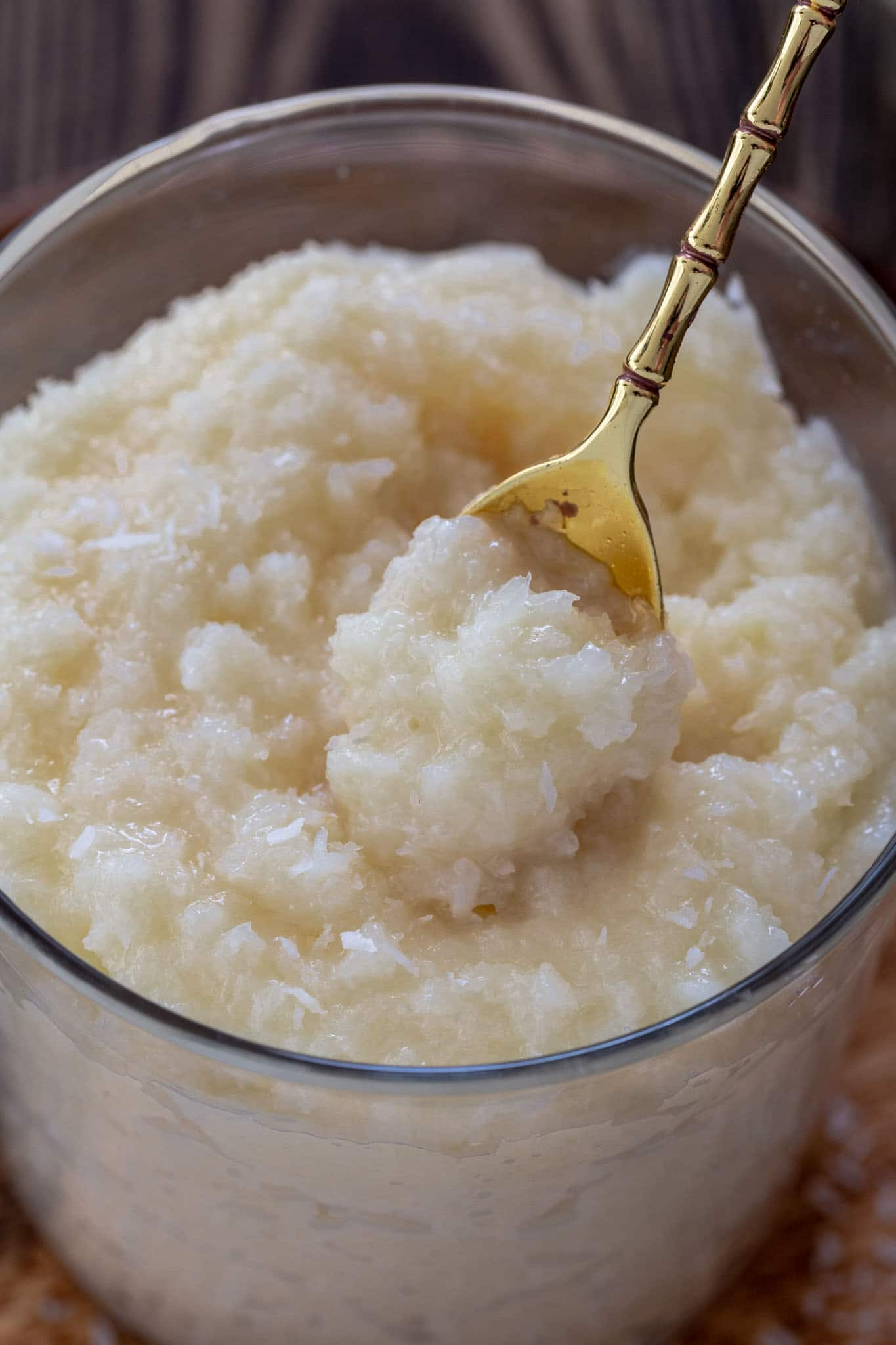 A close up of a spoonful of coconut pudding.