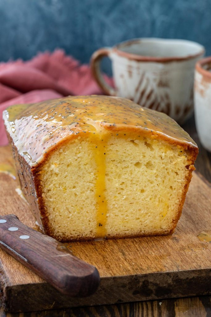 Fluffy and moist French Yogurt Cake topped with a tangy passion fruit yogurt glaze.