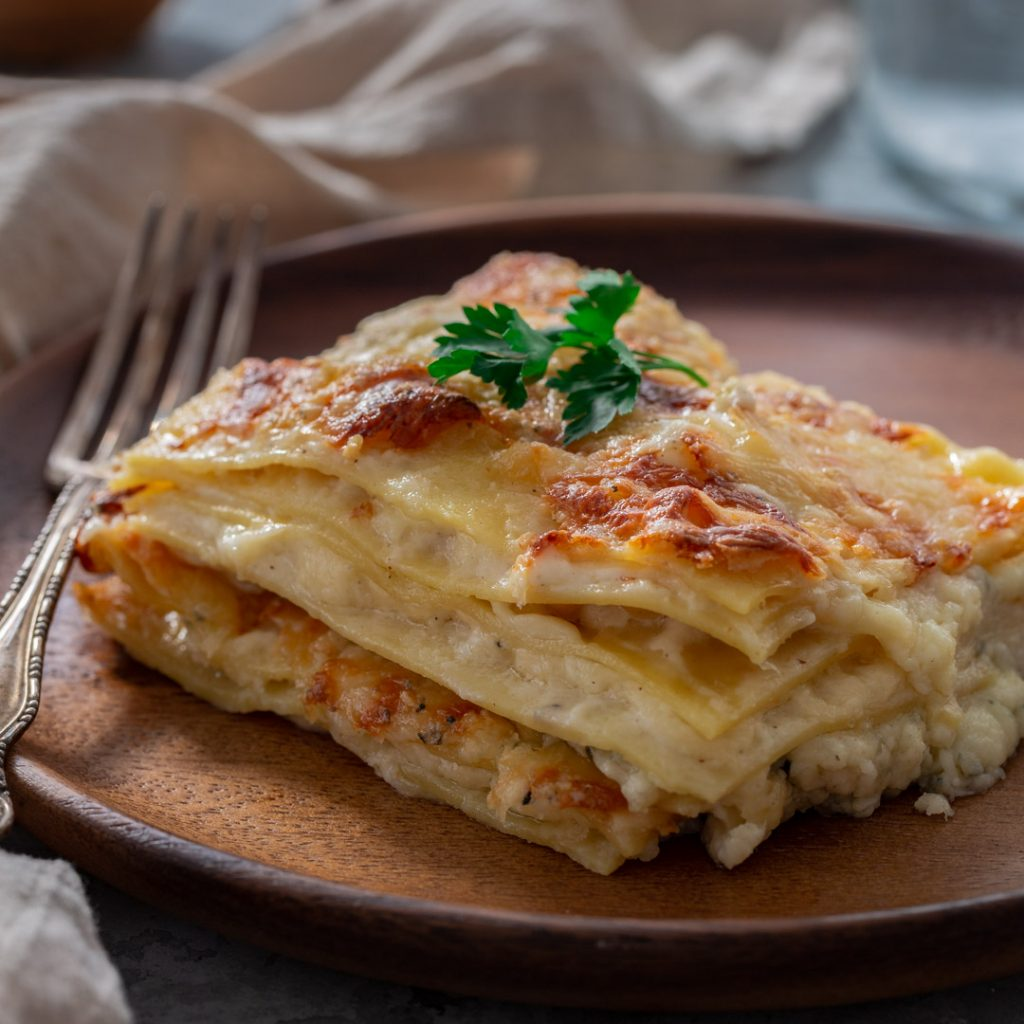 A slice of four cheese lasagna.