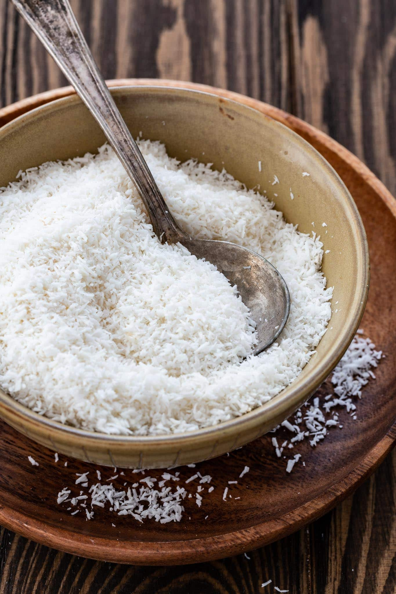 A small bowl of unsweetened shredded coconut.