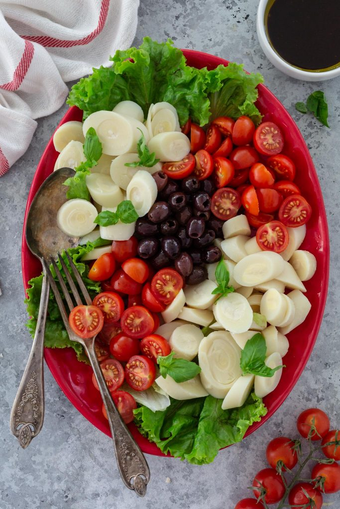 Hearts of Palm Salad with Cherry Tomatoes, small black olives, lettuce and basil.