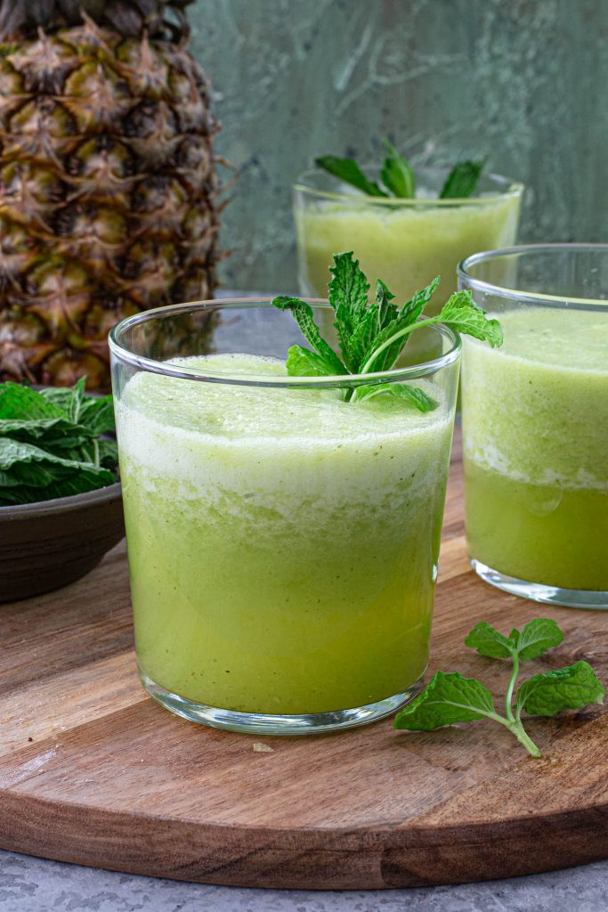 A glass of pineapple mint juice