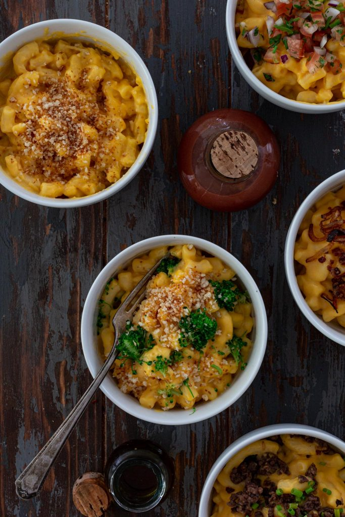 different bowls of Mac and cheese combinations