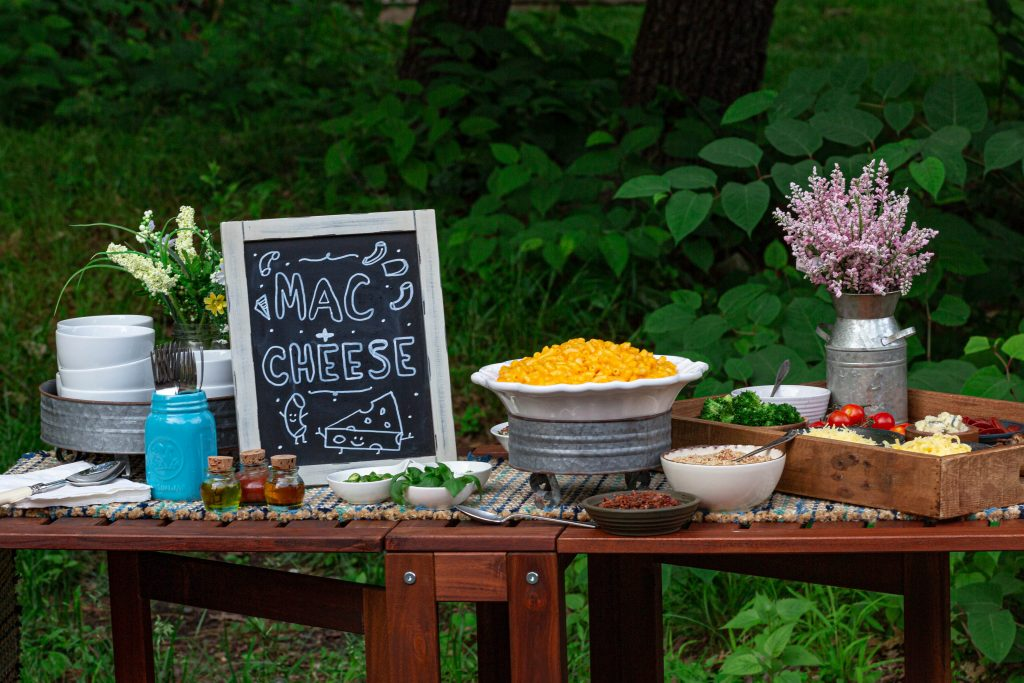 A macaroni and cheese station table.