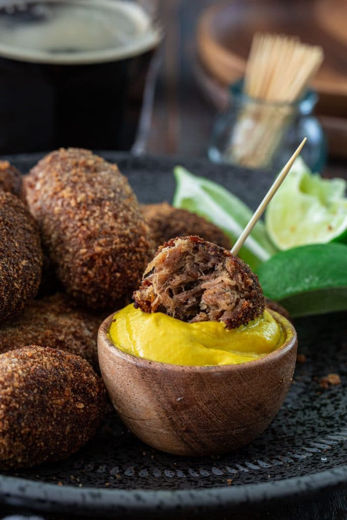Oxtail croquettes served with yellow mustard