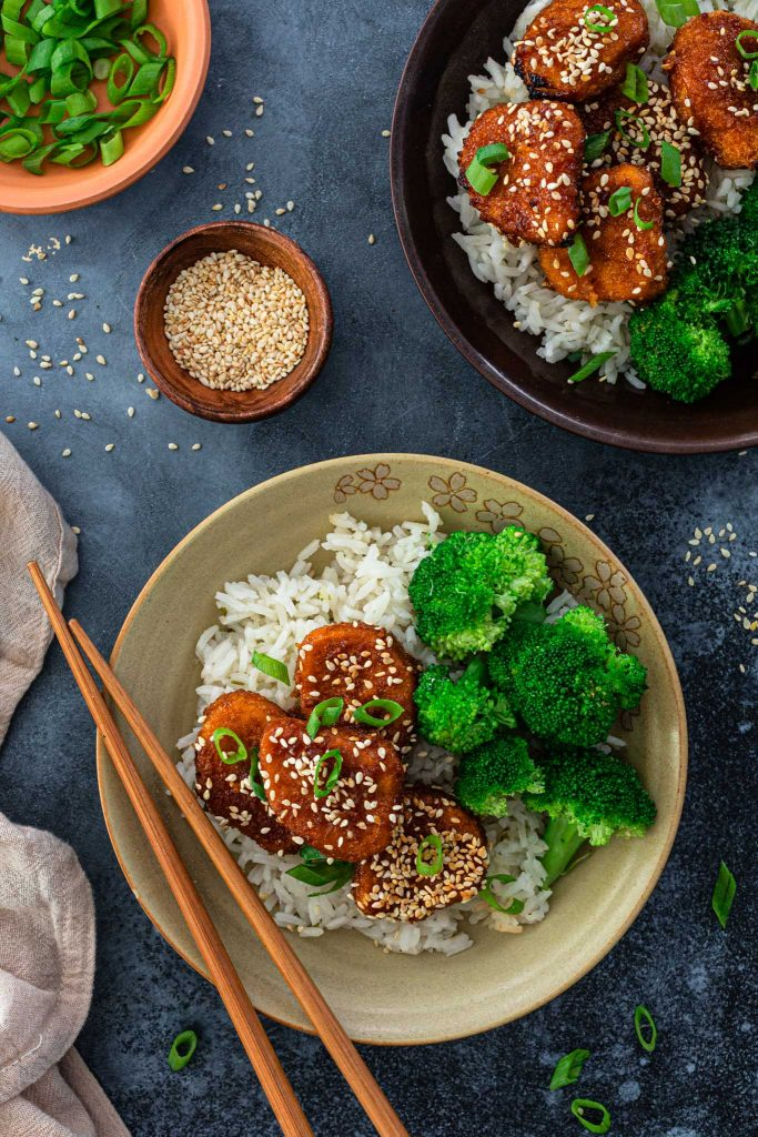 Honey glazed chicken nuggets served with rice and broccoli.