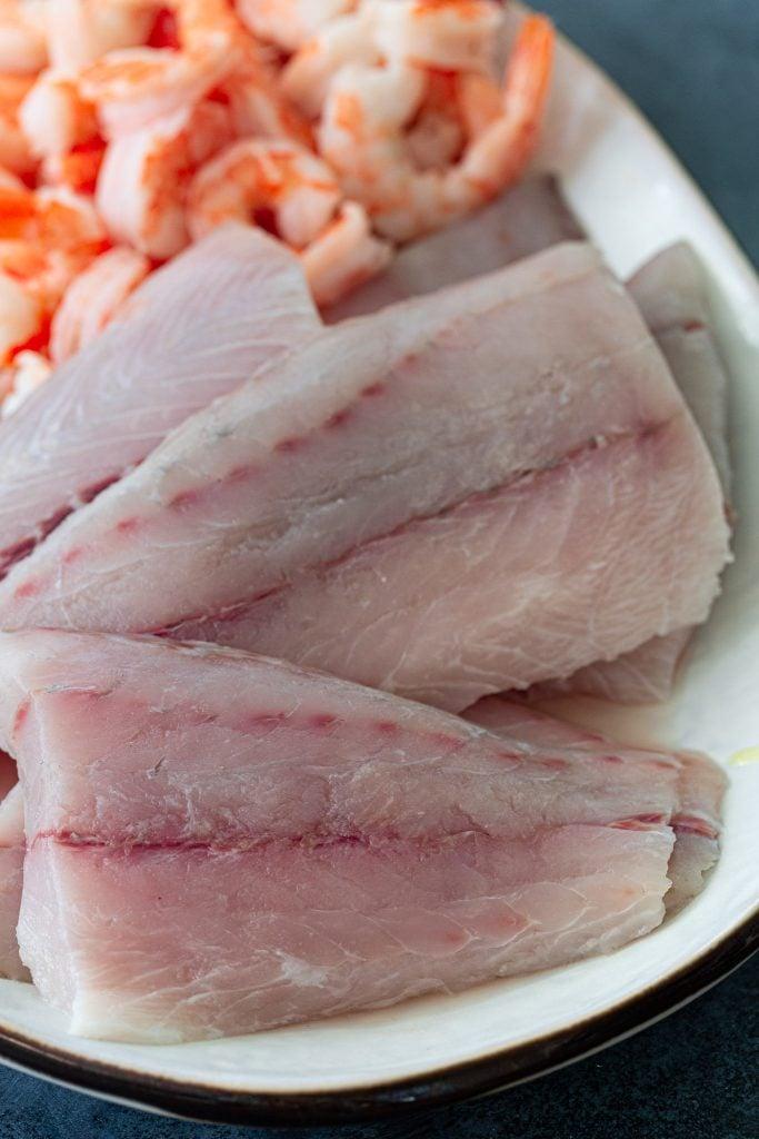 Sea bass and shrimp to make Moqueca