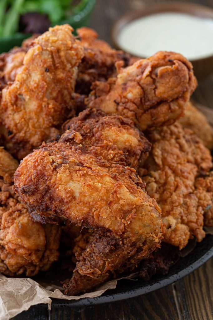 A close up of the crispiest fried chicken.