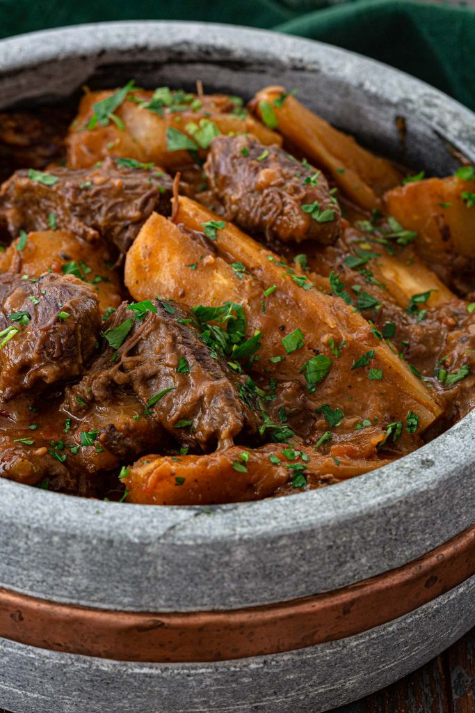 A pot of hearty beef stew made with short ribs and yucca.