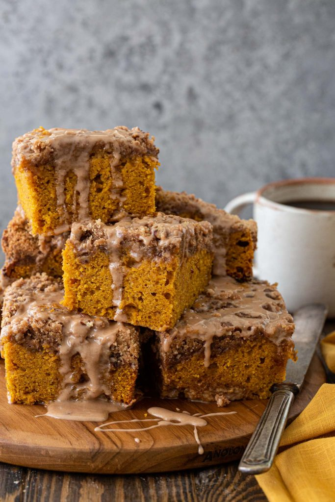 Freshly baked pumpkin coffee cake with pecan streusel and maple glaze.