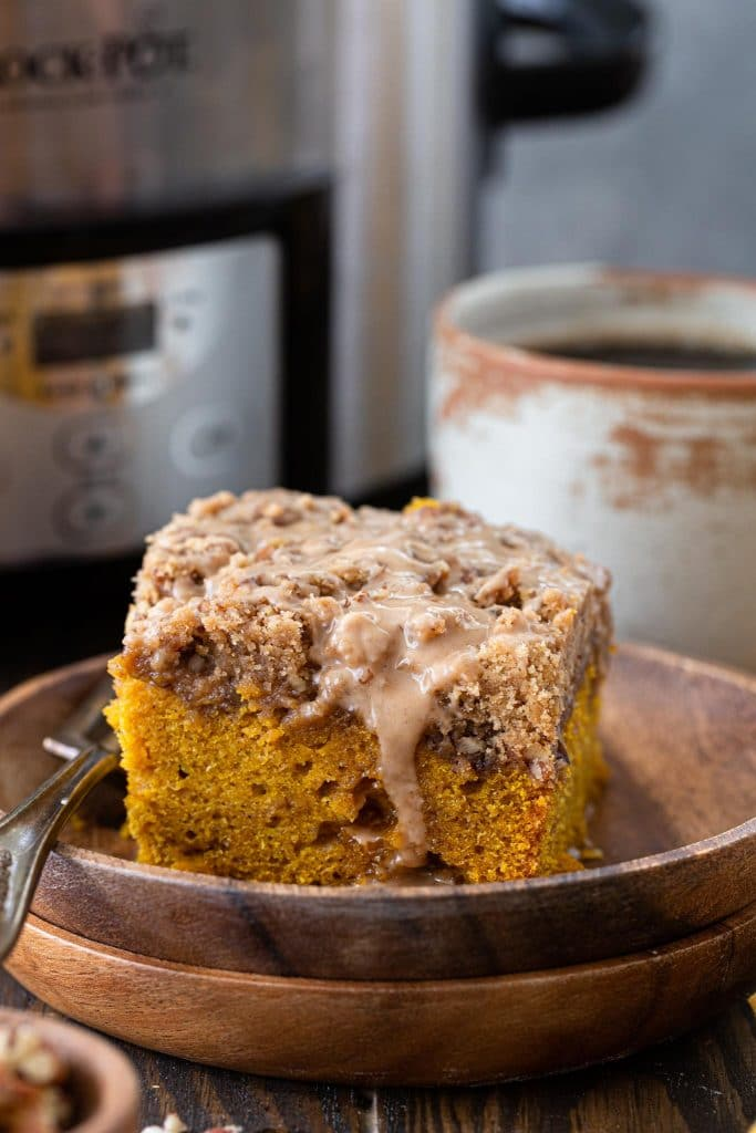 A slice of slow cooker pumpkin coffee cake.