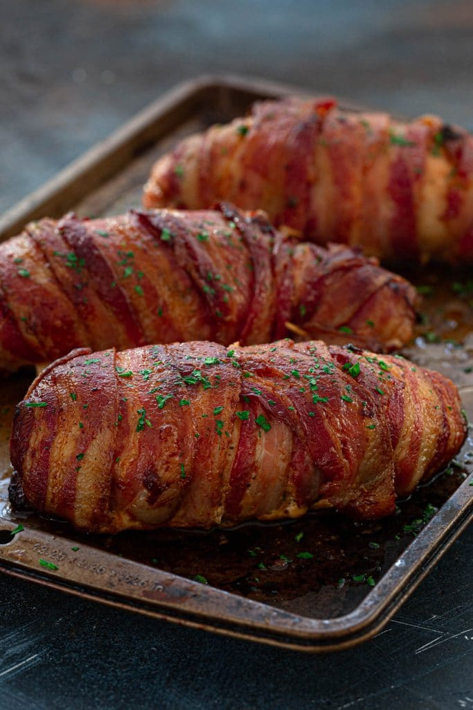 Bacon covered chicken breasts