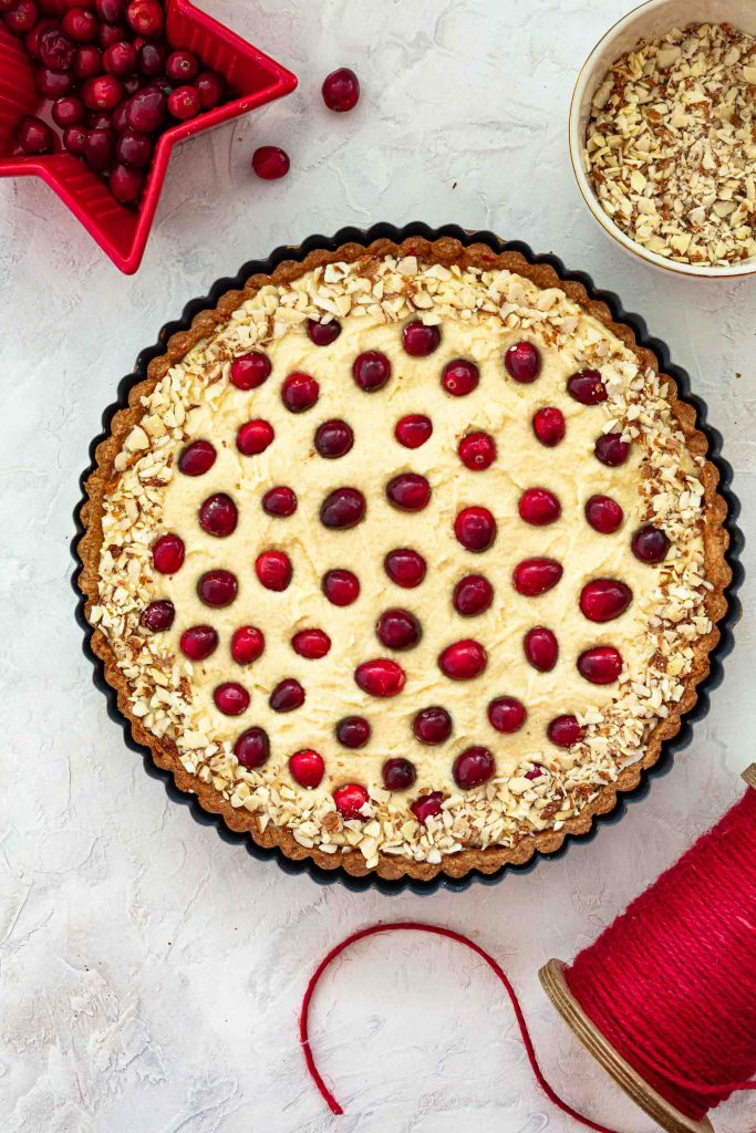 Tart studded with fresh cranberries and decorated with crushed almonds.