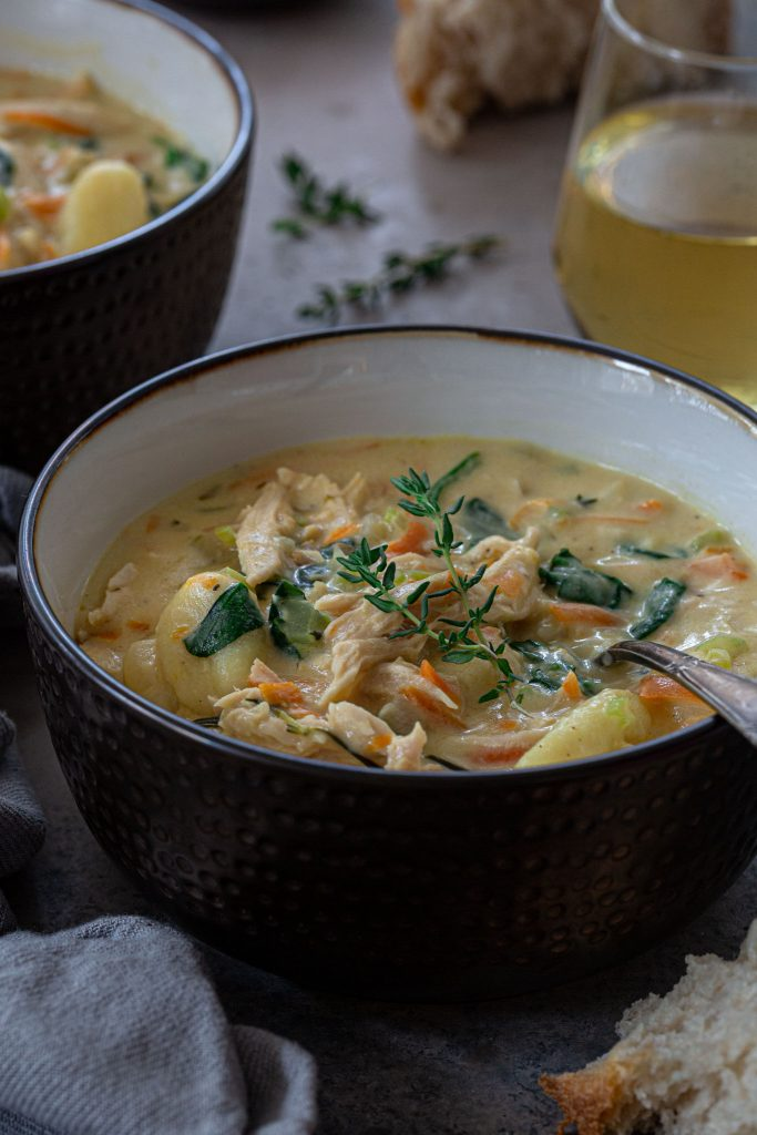 A bowl of creamy leftover turkey soup with gnocchi.