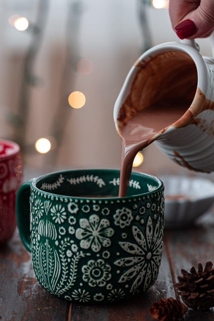 Pouring hot chocolate in a mug.