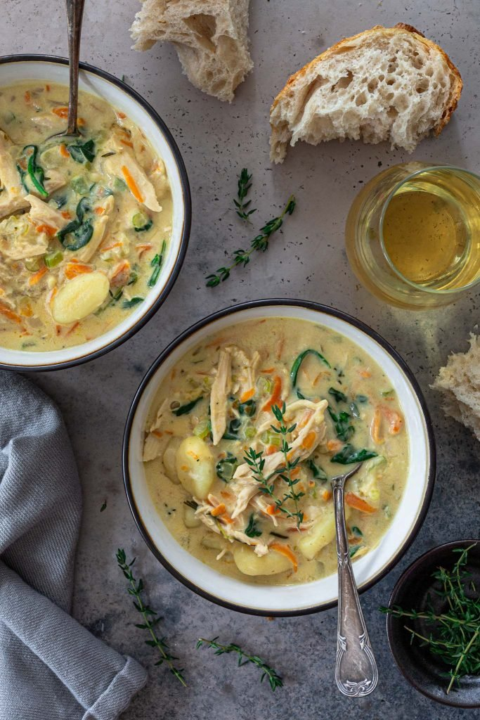 Creamy leftover turkey soup with gnocchi, served with crusty bread.