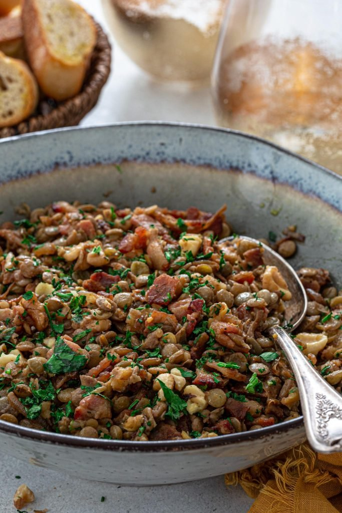 A salad made with green lentils, bacon, onions and nuts.