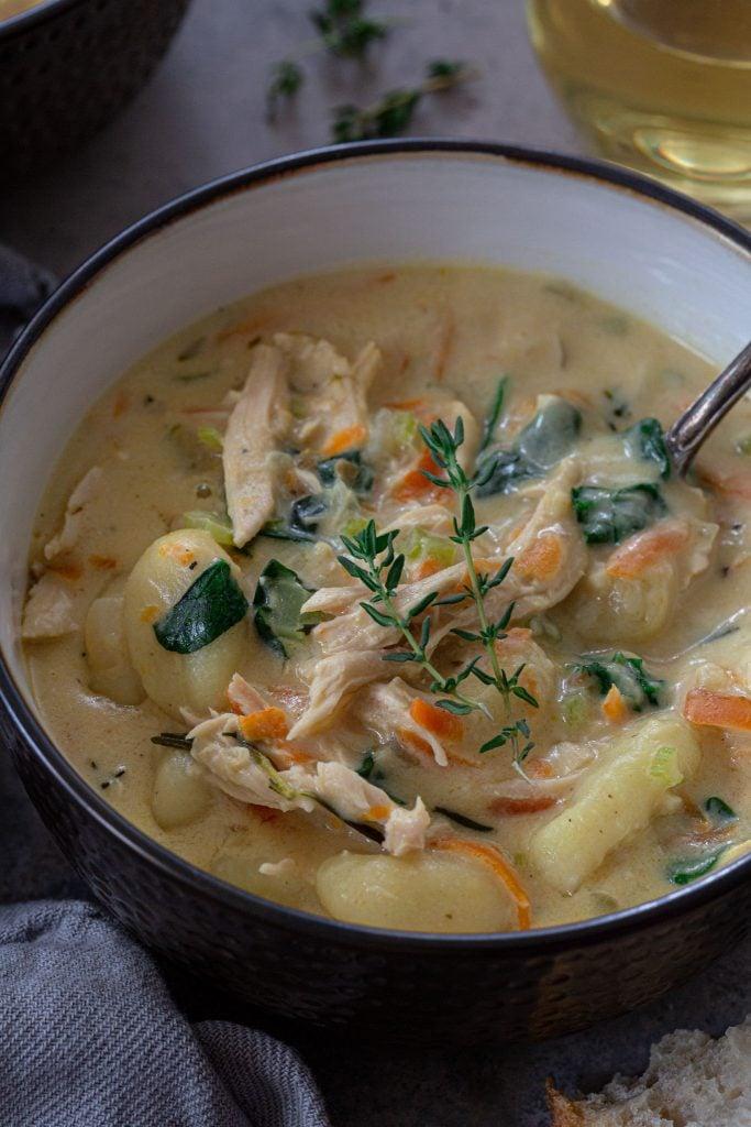 A soup made with shredded turkey, gnocchi, veggies and a creamy broth.