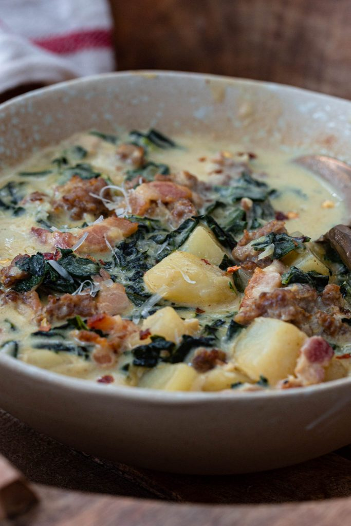 Cream broth with sausage, bacon, kale and potatoes.