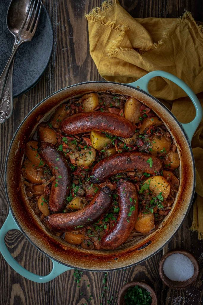 An Irish stew with sausages and potatoes.
