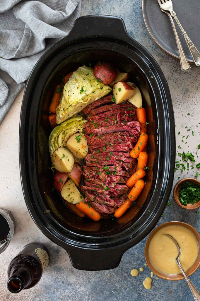 Corned beef cooked in the slow cooker with root vegetables and cabbage.