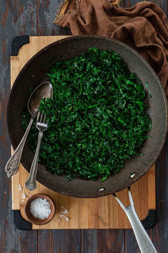 Sautéed Brazilian Collard Greens in a skillet.