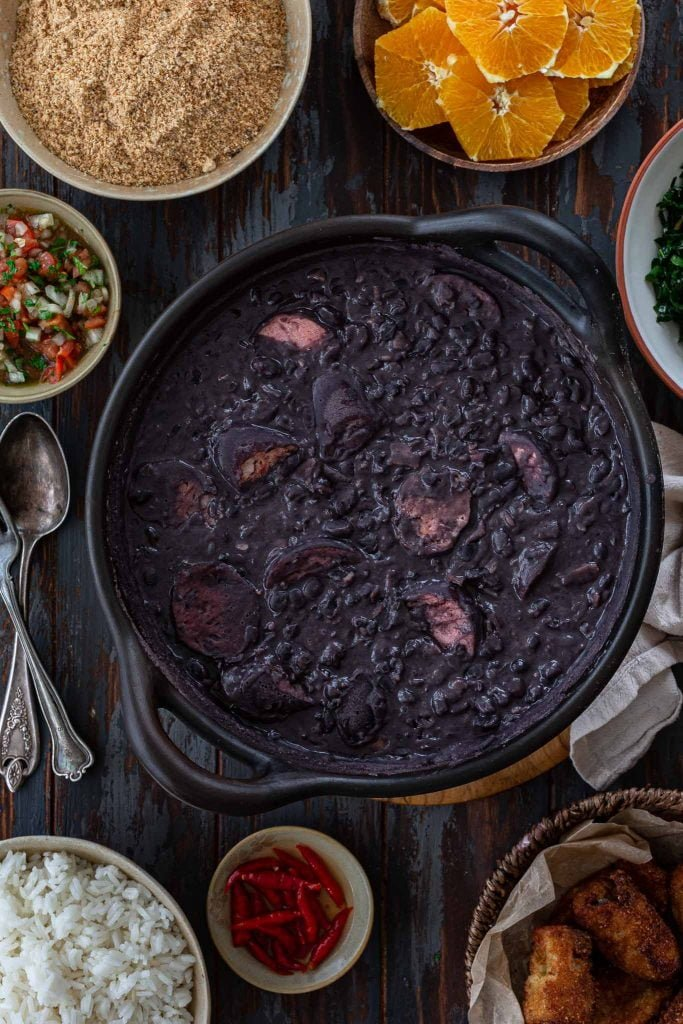 A big pot of feijoada with all the sides.