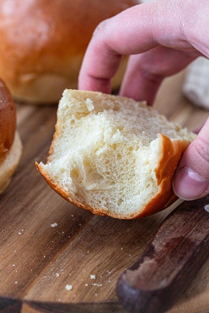 The soft crumb of a brioche bun.