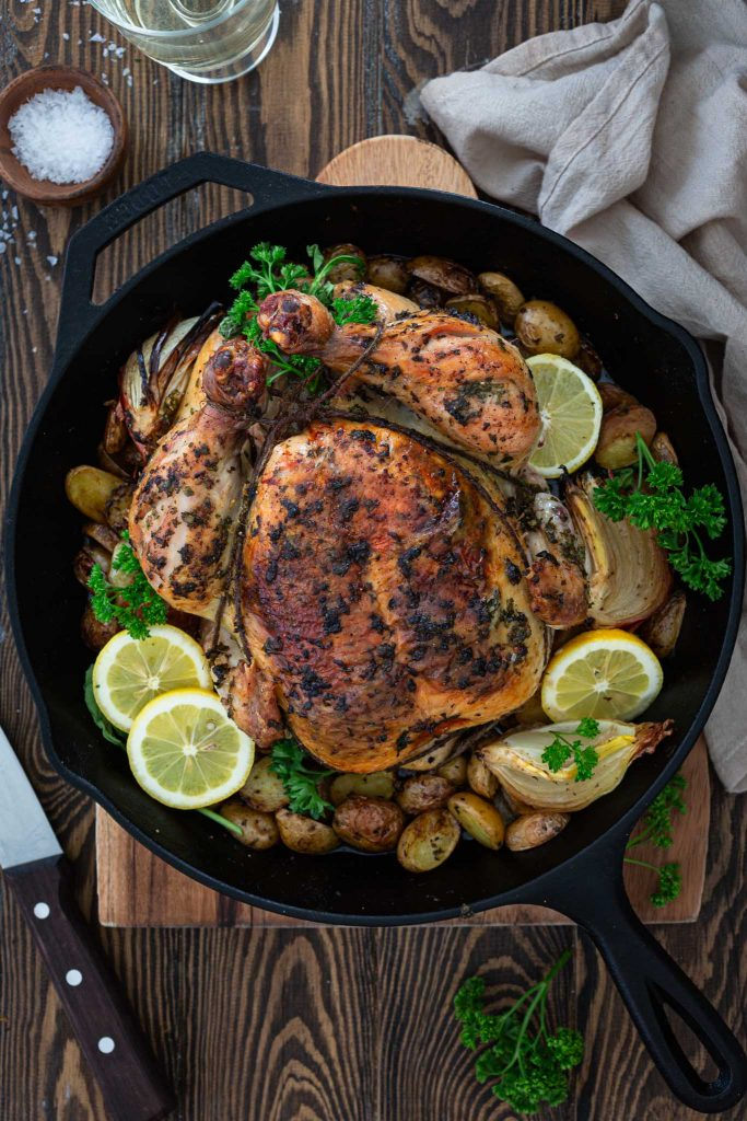Herb and lemon roasted chicken with potatoes