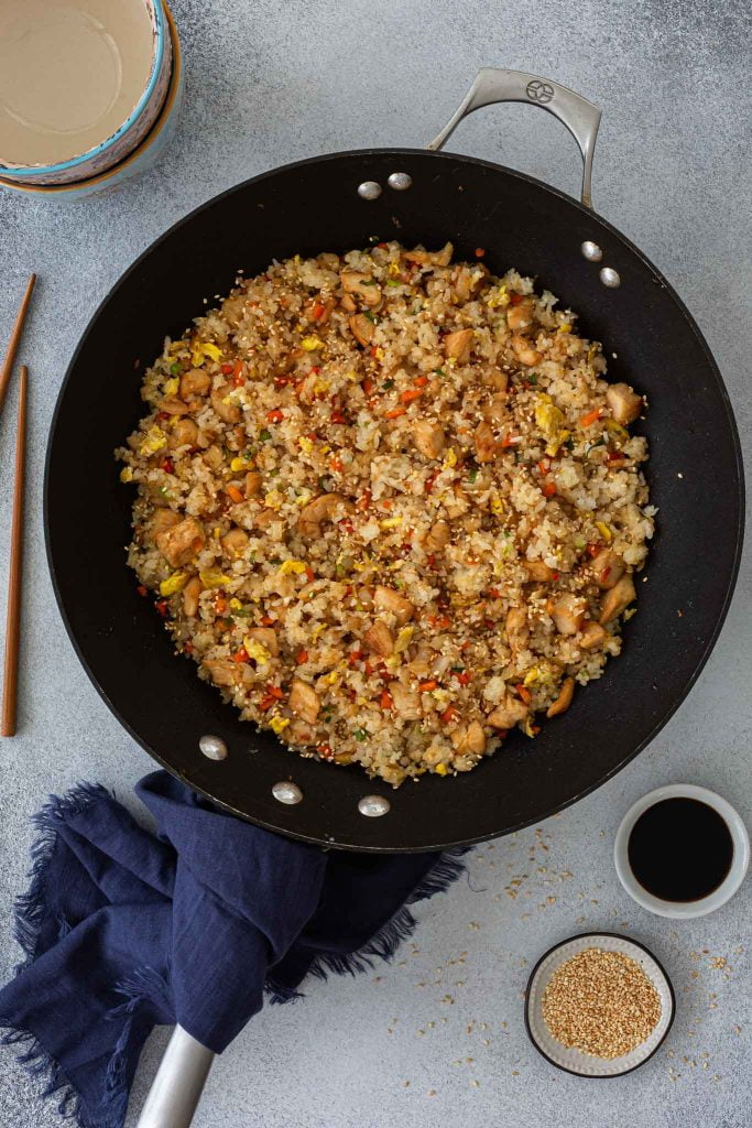 Chicken fried rice in a wok pan.