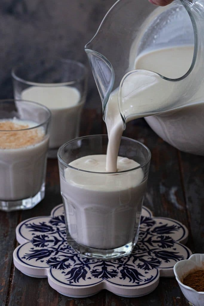 Pouring Mexican Horchata in a glass.