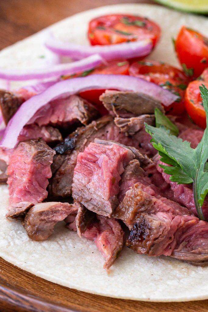 A close up shot of sliced flank steak.
