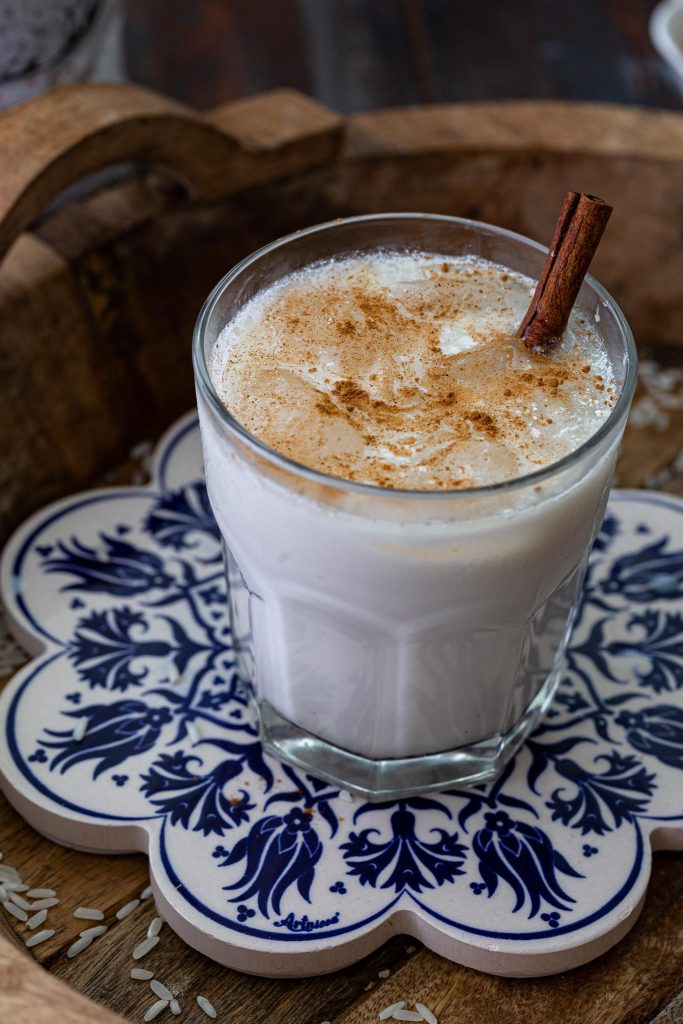 A glass of Mexican horchata garnished with cinnamon.
