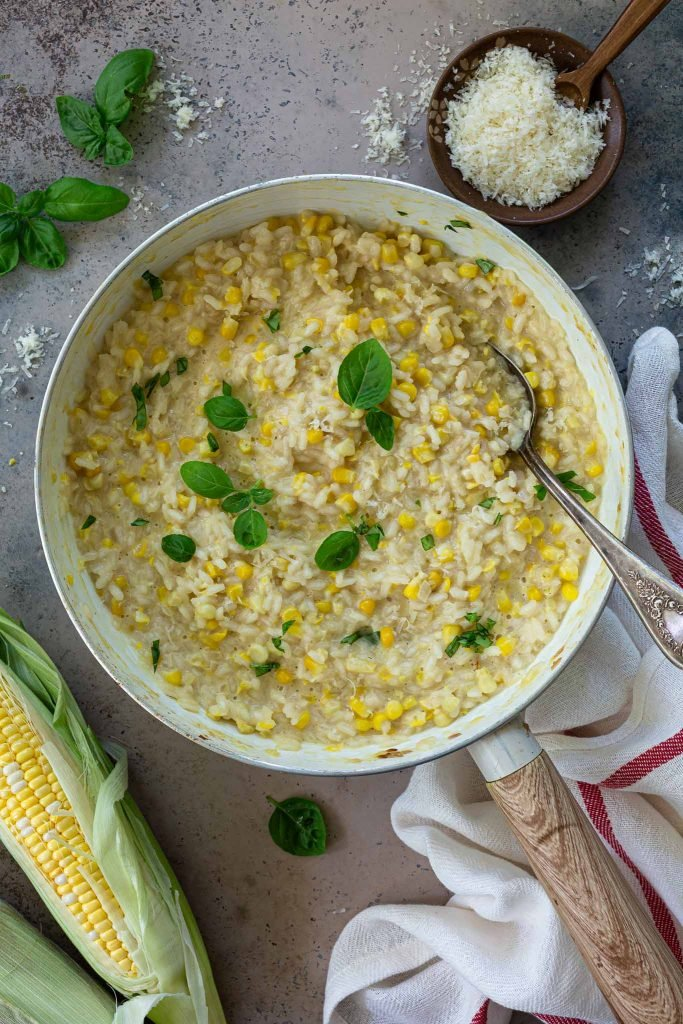 Sweet corn risotto in a pan.