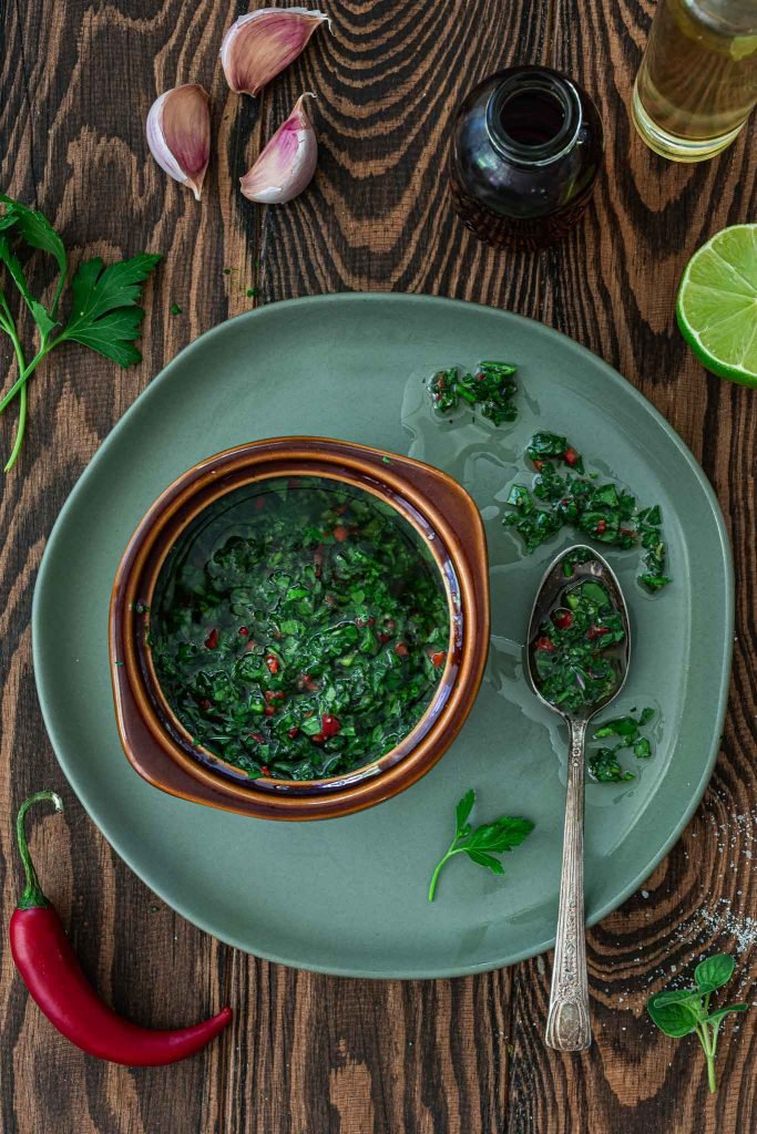 A flatlay overhead shot of Argentinian chimichurri sauce.