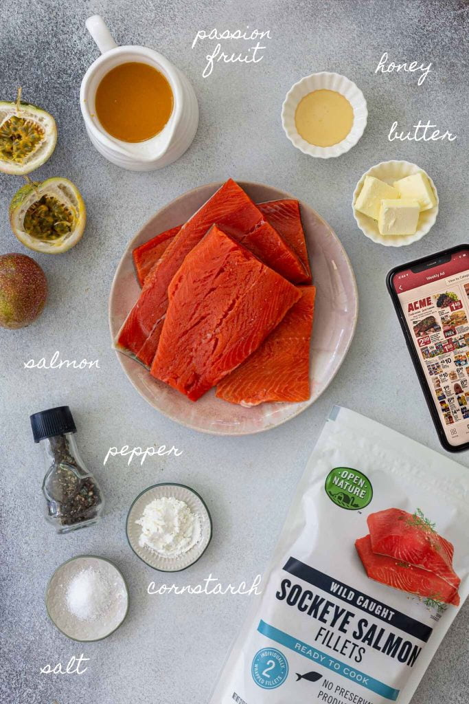 A photo of all the ingredients used to make the dish: salmon, passion fruit pulp, honey, butter, pepper, salt and cornstarch. You can also see a phone and the package of the frozen salmon.