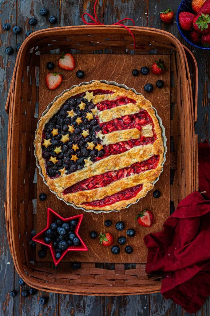 Stars and stripes berry pie in a basket.