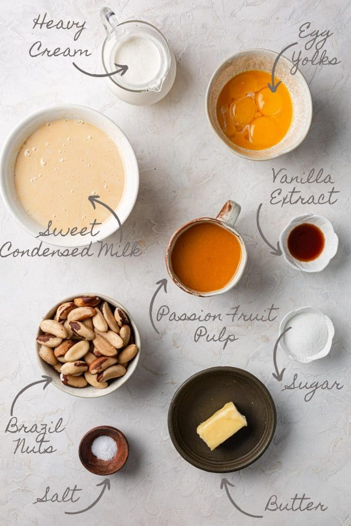 A photo of the ingredients. Heavy cream, sweet condensed milk, yolks, vanilla extract, passion fruit pulp, Brazil nuts, sugar, butter and salt.