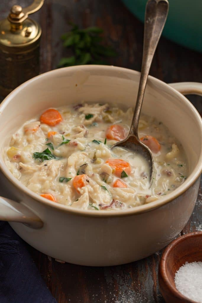 A bowl of creamy chicken and rice soup.